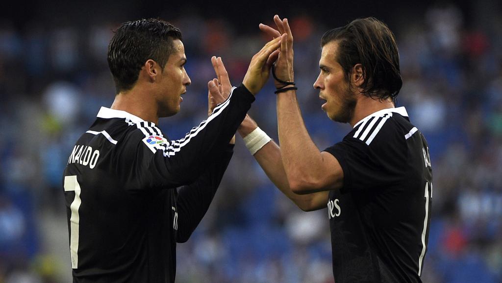 Le Portugais Cristiano Ronaldo et le Gallois Gareth Bale, en mai 2015. LLUIS GENE / AFP